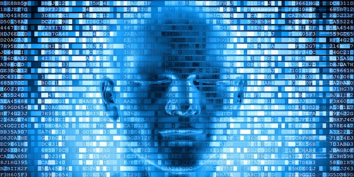 Human head emerging from computer code