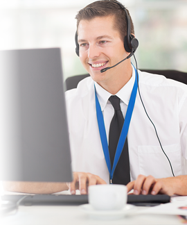 img-man-in-front-of-computer-talking-on-headset