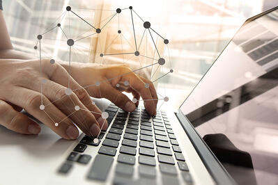 img-man-using-computer-with-interconnected-dots-01